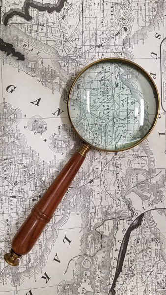 Map and Magnifying Glass - photo by Lorelle VanFossen.