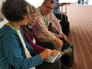 Genealogists helping each other on laptop during FGS conference 2017 - photo by Lorelle VanFossen