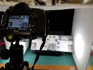 Photographing yearbook with portable studio and digital camera.